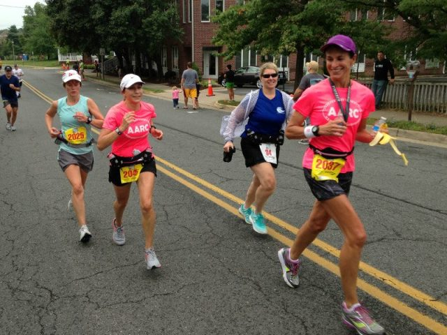 Stacey Miller (r) leads Jeanne Friberg  and Sandra Starke to the finish of the Leesburg 20k while 5k runner Susan Shurtleff tags along. Photo: Charlie Ban