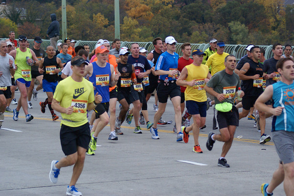 Runners cross the Key Bridge four miles into the 2012 Marine Corps Marathon.                                   Photo: Cheryl Young