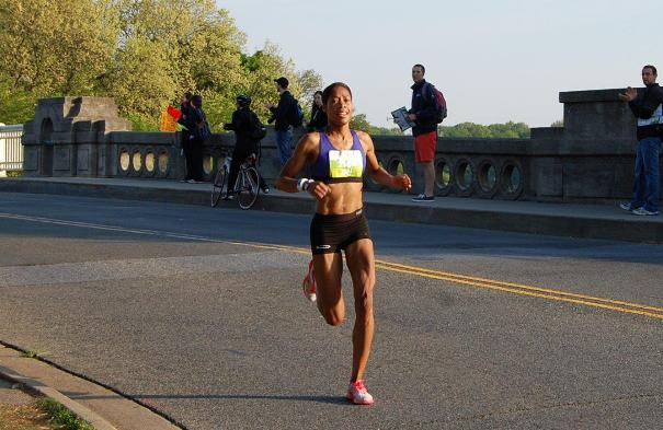 Samia Akbar nears the 10k mark in 37:28 as she leads the Nike Womens Half Marathon.                          Photo: Charlie Ban