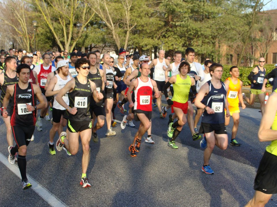 Men representing a variety of teams lead the charge at the RRCA Club Challenge.                                                              Photo by Chris Farmer