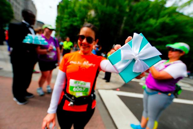 Claudia Seglas of Miami Springs, Fla. shows off her prize at the finish line.     Photo: Brian Knight  Swim Bike Run Photography