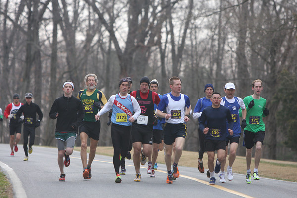 Doug Woods (229) scopes out his competition at the MCRRC Piece of Cake 10k. Woods went on to win. Photo: Conroy Zien