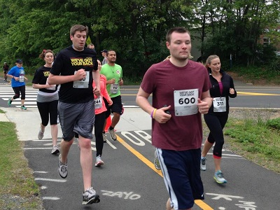 Grant Beck leads the way at the We've Got Your back 5k. Photo: Charlie Ban