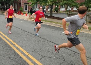 Tyler Duke runs away from Ryan Flynn (left) and some other guy at the end of the Leesburg 20k. Photo: Charlie Ban