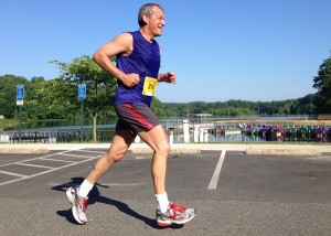Stephen Nettl of Reston passes Lake Accotink during the Springfield 15k. He finished 83rd in 1:21:47. Photo: Charlie Ban