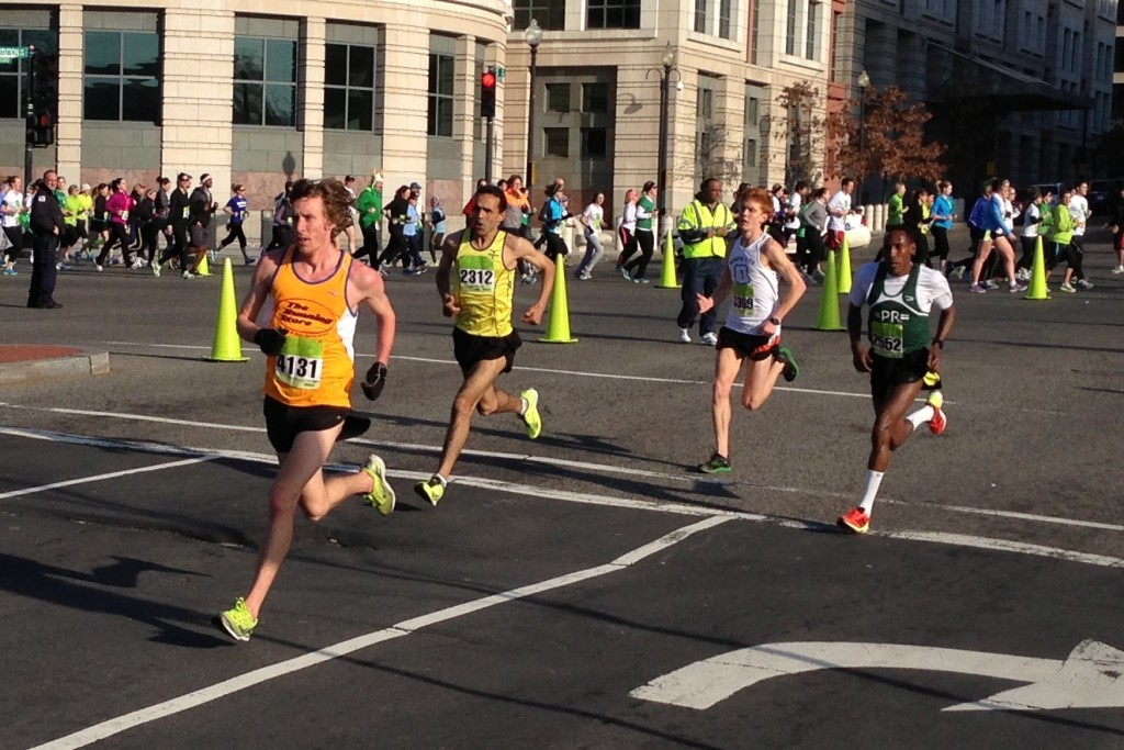 Jordan McDougal leads Elarbi Khattabi, Sean O'Leary and Gurmessa Megerssa in the St. Patrick's Day 8k.                 Photo: Charlie Ban