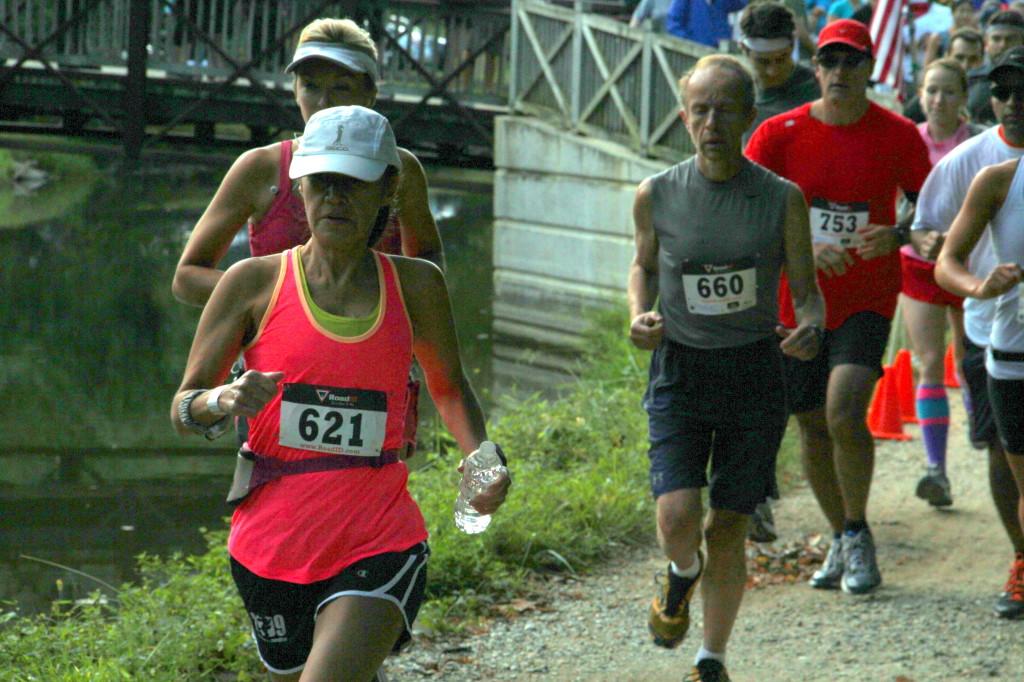 Grace Hierro, Eugene Koonin and Grant Powell chase Boston qualifiers at the Abebe Bikila Marathon. Photo: Antonio Estrada