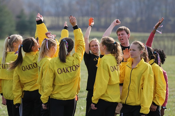 The Oakton girls team members pump each other up for the 2012 Concorde District meet. Photo: Ed Lull