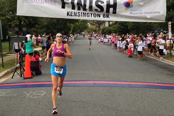 Jennifer Panetta crosses the finish line of the Kensington 8k just ahead of Jocilyn McNally. Photo: John Seabreeze