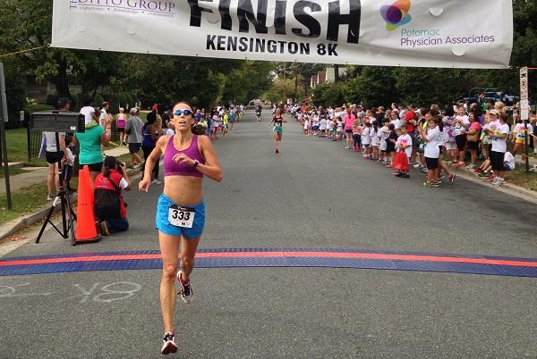 Jennifer Panetta crosses the finish line of the Kensington 8k just ahead of Jocilyn McNally. Photo: John Seabreeze
