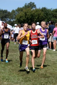 Lake Braddock's Alex Corbett, James Madison's Matt Callem and Chantilly's Dakota Lange try to maintain their gap on Battlefield's Aaron Hill. Photo: Ed Lull