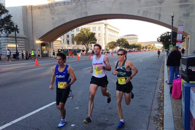 Dave Wertz, Andrew Pitts and Ray Pugsley cruise along in mile eight of the Army Ten-Miler. Photo: Charlie Ban