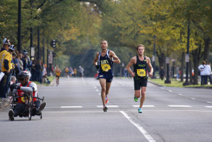 "Patrick Fernandez and Richard ""Skeeter"" Morris barrel down Independence Avenue in mile 16 of the Marine Corps Marathon. Photo: Cheryl Young"