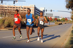 Girma Gebre, right, pulled away from Nahom Mesfin, center, and Siraw Kebede, shortly after cresting this hill to win the Woodrow Wilson Bridge Half Marathon this morning. Photo: Dickson Mercer