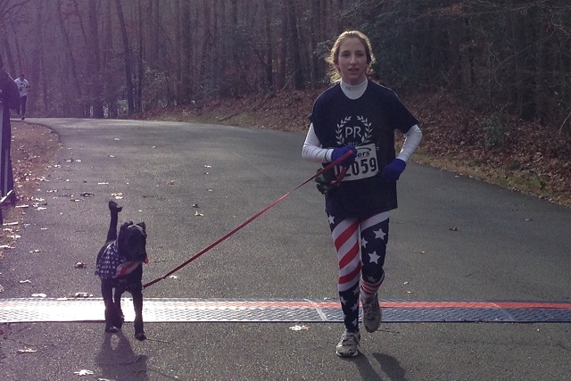 Rose Spahn, 12, of Fairfax Station raced with her dog, Kenai, in the Drumstix Dash 8k at Burke Lake Park  Saturday, Nov. 30.