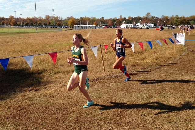 George Mason's Bethany Sachtleben pulls away from Richmond's Jill Prentice on her way to winning the Atlantic 10 cross country individual title. Photo: Charlie Ban