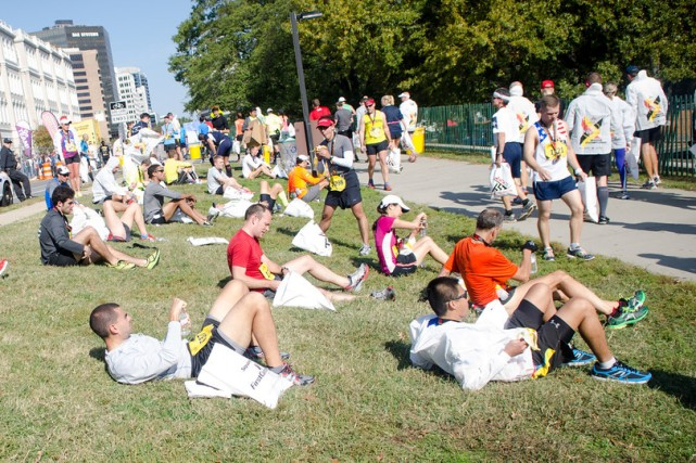 Marine Corps Marathon runners relax and convalesce after the race. Photo: Jimmy Daly