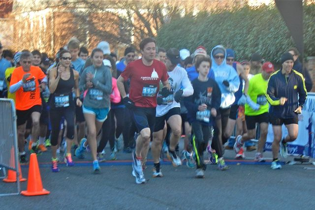 Chris Carney leads the pack out of the gate at the Spend Yourself 5k. Photo: Rachael Burke