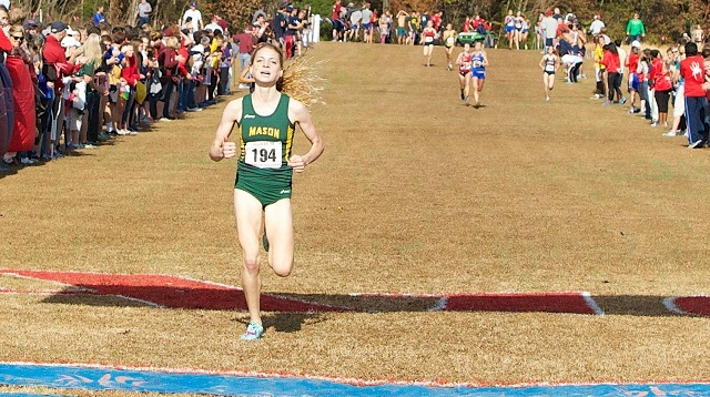 Bethany Sachtleben crosses the finish line in first at the 2013 Atlantic 10 Cross Country Championships. Photo: Keith Lucas