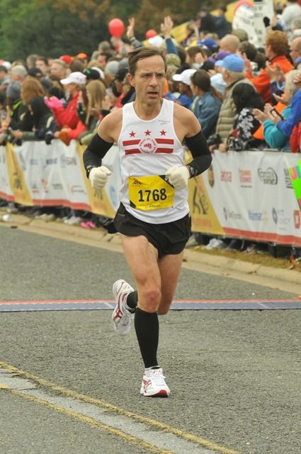 Alan Pemberton closes in on a 60-69 age group win at the 2013 Marine Corps Marathon. Photo: MarathonFoto