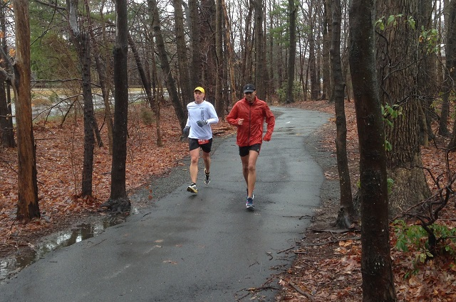 Two runners brave the freezing rain at the Runners Marathon of Reston. Photo: Charlie Ban