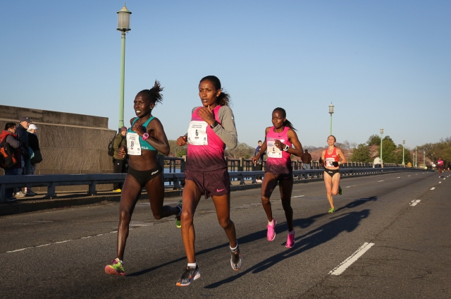 Aliphine Tuliamuk-Bolton and Mamitu Daska try to hold their lead over Janet Bawcom and Sarah Hall halfway through the Cherry Blossom Ten Mile. Photo: Vladimir Bukalo