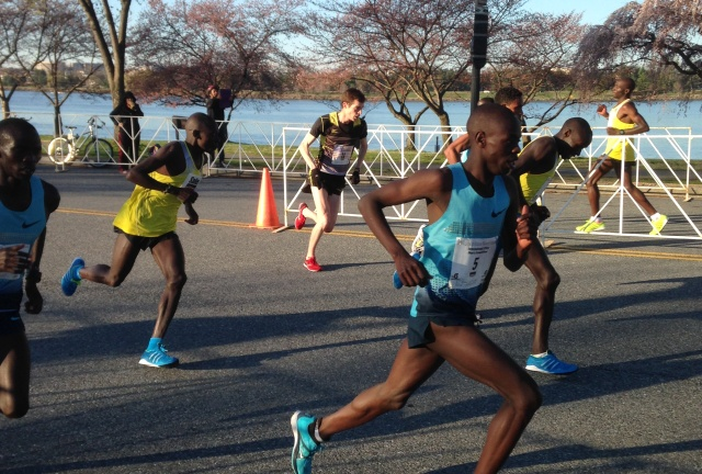 The lead pack, including U.S. 10 mile champion Christo Landry,center, navigates a turn in mile five of the Cherry Blossom Ten Mile. Photo: Charlie Ban