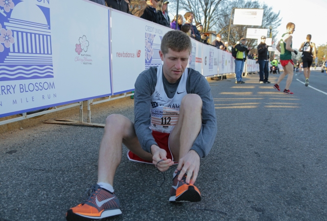 Brian Fuller ties his shoes before the start of the Cherry Blossom Ten mile. Photo: Vladimir Bukalo