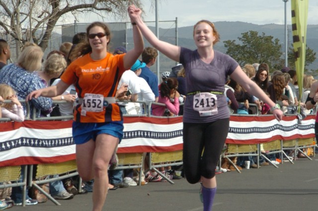 Alana Miller (left) and Ashley Vaughan near the finish line of the 2013 Napa Marathon. Photo: MarathonFoto