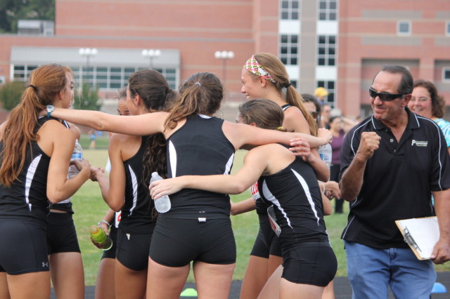 Jim Vollmer celebrates when he learns his Poolesville girls cross country team won the 2013 divisional title. Photo: Melanie