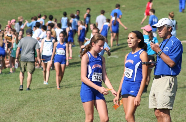 Sherwood High School Coach Dan Reeks at the Bull Run Invitational with Sherwood runners Maddie Peloff, left, and Grace McDonald. Photo by Debbie Harman