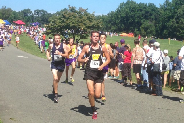 Westfield's Johnny Pace leads Woodson's Robert Lockhart and Lake Braddock's Alex Corbett and Kevin Mongue to the two mile mark at the Monroe Parker Invitational. Photo: Charlie Ban