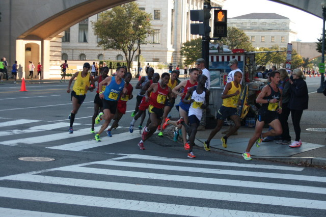 The men's lead pack turns onto the 14th Street Bridge at mile 6.5 of the Army Ten-Miler. Photo: Charlie Ban