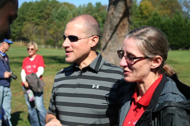 Mike and Louisa Puffett talk to members of Mike's DeMatha team. Puffet coaches the Elizabeth Seton team. Photo: Charlie Ban