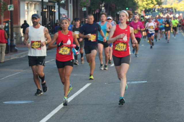 Kelly Swain, left, runs with teammate. Photo: Charlie Ban