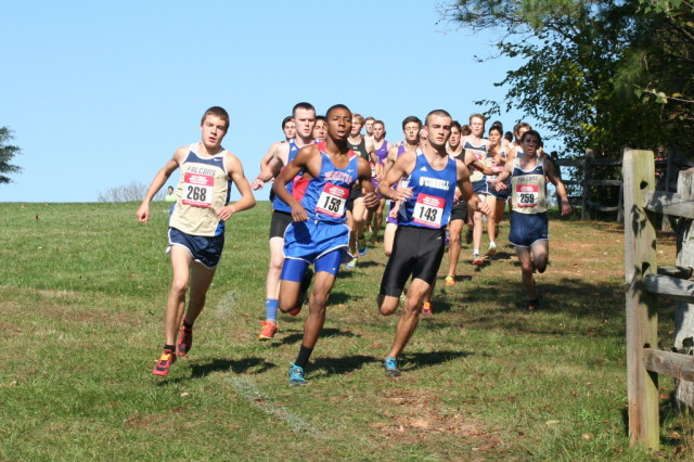 Jack Wavering( Good Counsel), Hampton Holmes (DeMatha) and Kevin Dannaher (O'Connell) battle for the lead early into the WCAC Championships. Photo: Charlie Ban