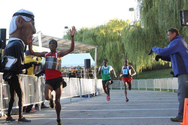 Girma Gebre edges Gosha Tefera and Derege Demie at the Woodrow Wilson Bridge Half Marathon. Photo: Clay Shaw/Karen Mitchell