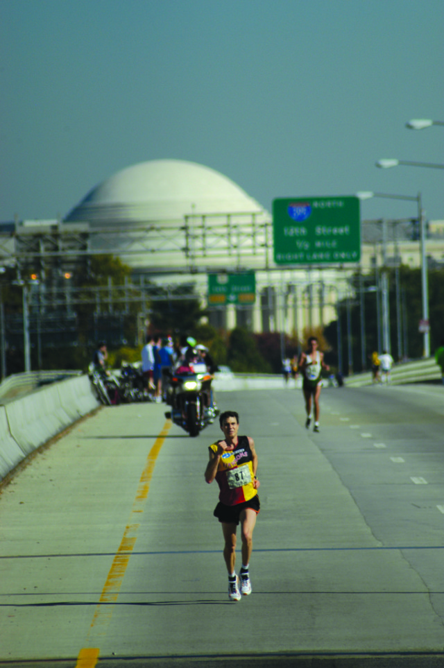 Carl Rundell leads Ruben Garcia across the 14th Street Bridge during the 2005 Marine Corps Marathon. Garcia would go on to win in 2:21:18, eight seconds ahead of Rundell. Photo: Courtesy of the Marine Corps Marathon via Steve Nearman, author of Marine Corps Marathon: An Epic Journey in Photographs