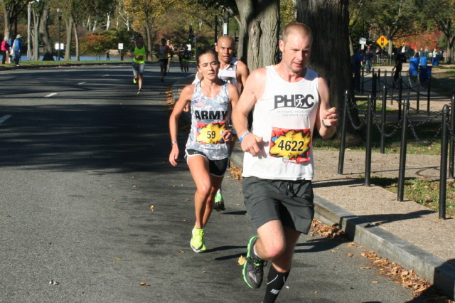 Army. Capt. Meghan Curran, in second place at the Marine Corps Marathon. She would go on to take the lead a mile later and hold on to win her first marathon. Photo: Charlie Ban