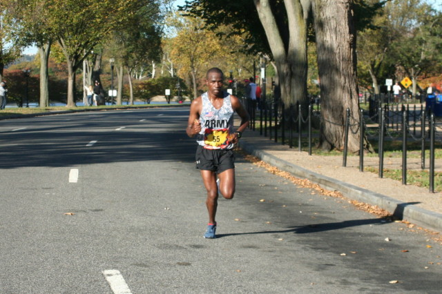 Marine Corps Marathon winner Samuel Kosgei nearing the 17 mile mark in second place. Photo: Charlie Ban
