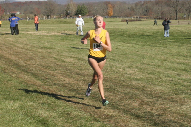 Oakton's Allie Klimkiewicz closes in on third place in the 6A race, and the start of another state championship for the Cougars. Photo: Charlie Ban