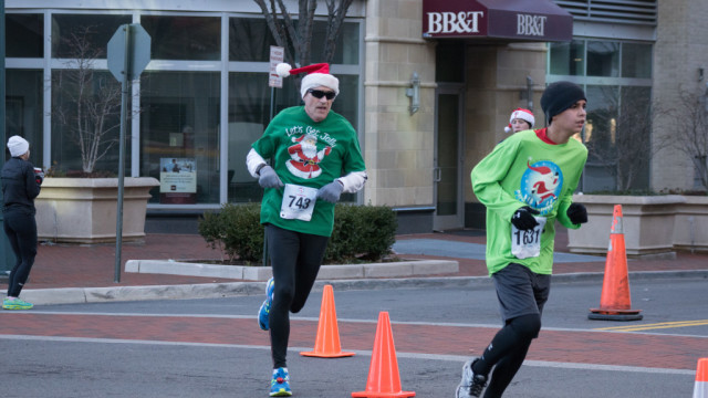 Thomas Foley's (left) idea of getting jolly is kicking to the finish of the Run with Santa. Photo: Cheryl Young