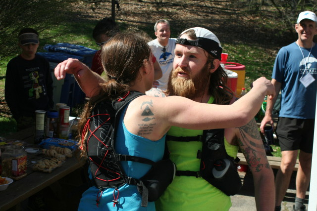 David Lister hugs his wife, Ashley, after finishing the Bull Run 50 Miler. Ashley won the women's overall title. Photo: Charlie Ban