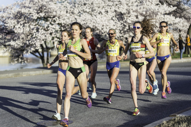 Silver Spring resident Lindsay Flanagan leads a chase back of elite women on the Cherry Blossom course Sunday. Photo: Dustin Whitlow/D. Whit Photography