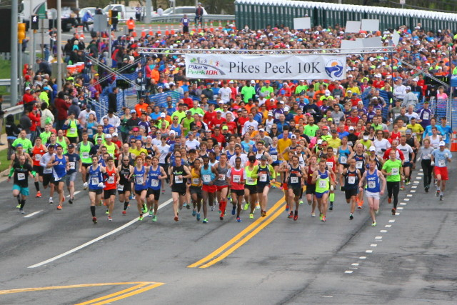Runners pour out of the Pikes Peek 10k starting line. Photo: Dan and Alex Reichmann