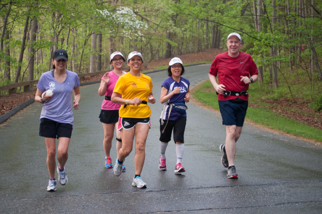 Joe Divel (right) runs through Lake Needwood Park during a First Time Marathoners practice. Photo: Hai D. Nguyen