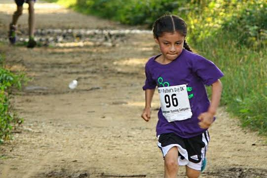 A kid's kilometer participant makes dad proud at the Father's Day 8k. Photo: Tina Morrison