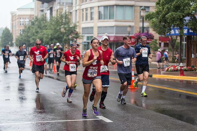 Sarah Bord, of Lorton, leads a group of Team RWB runners at the Firecracker 5k. Photo: Dustin Whitlow