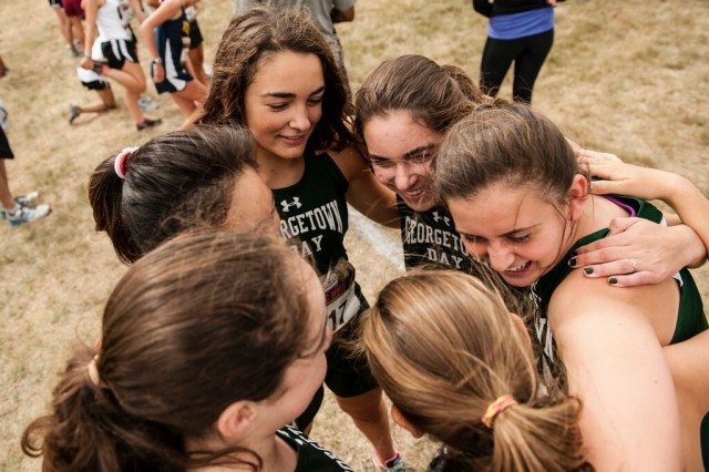Georgetown Day School's freshmen girls huddle before their race. Photo: Marleen Van den Neste