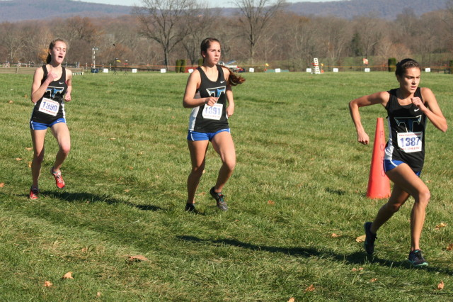 Tuscarora final scorers, and a displacer, for insurance purposed, push the last stretch of the 5A race. Photo: Charlie Ban